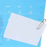Papier-klem en korte brief op kalender Royalty-vrije Stock Fotografie