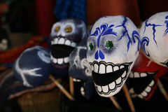 Papier Mache Day of the Dead skulls and rattles Stock Photos
