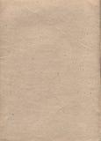 Papier mit einem beige Farbton und einem Bruch Lizenzfreie Stockbilder