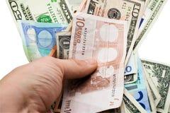 Papier-monnaie à disposition Images stock