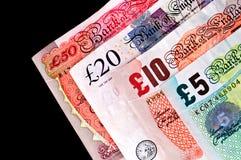 Papier-monnaie de devise BRITANNIQUE - billets de banque. Images stock