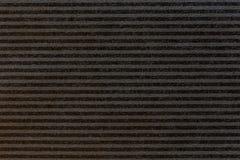 Papier noir de rayure Photographie stock