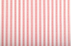 Papier peint avec le modèle rayé rouge Photos stock