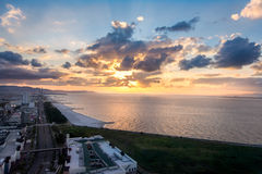 Papier peint idyllique de paradis de coucher du soleil Images stock