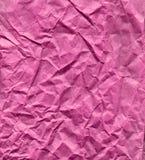 Papier rose froissé Photographie stock