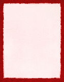 Papier rose sur le rouge Photos libres de droits