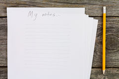 Papier und Bleistift lizenzfreies stockbild