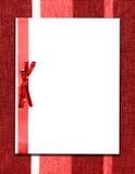Papier und Bogen auf rotem Gewebe Stockbild