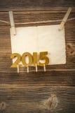 Papier und 2015 goldene Zahlen Lizenzfreie Stockfotos