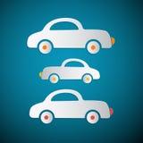 Papierautos auf blauem Hintergrund Lizenzfreies Stockfoto