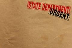 Papierbeschaffenheit mit State Department und dringenden Stempeln Stockfoto