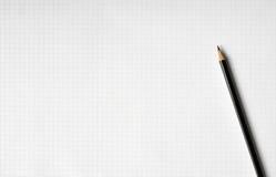 Papierblatt mit einem Bleistift Stockfoto