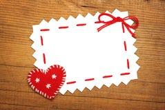 Papierblatt- und Weihnachtsherz Stockfoto