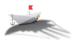 Papierbootsorigami mit dem Schatten eines großen Schiffs - begrifflich Stockfoto