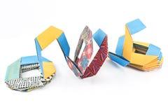 Papierformen des bunten Origamis Stockfoto