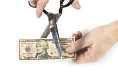 Papiergeld met schaar wordt gesneden die Devaluatieconcept royalty-vrije stock foto's