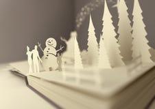 Papierhandwerks-Weihnachtsgeschichte Stockfotos
