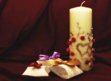 Papierkästen und Kerze Stockbilder