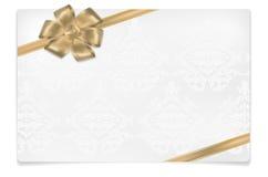 Papierkarte mit goldenem Bogen und Blumenverzierungen Stockbild