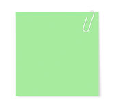 Papierklammer, die ein Blatt des unbelegten Papiers anhält Stockbild