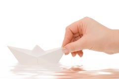 Papierlieferung in einer Hand Lizenzfreie Stockfotos