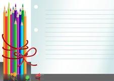 Papiernotizbuch mit Farbenbleistiften Lizenzfreies Stockbild