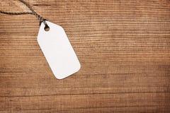 Papierowa etykietki etykietka na drewnie Obrazy Stock