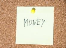 Papierowa notatka pisać z pieniądze inskrypcją na korek desce Zdjęcie Stock