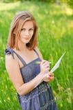 papierowa szkotowa kobieta pisze potomstwach Zdjęcie Stock