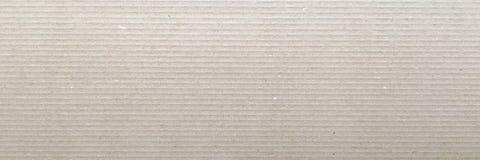 Papierowa tekstura - brown Kraft prześcieradła tło Textured przetwarza papier powierzchnię obrazy stock