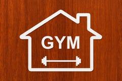 Papierowy dom z GYM tekstem inside Abstrakcjonistycznego sporta konceptualny wizerunek Zdjęcie Royalty Free