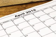 Papierowy kalendarzowy Kwiecień 2018 na drewnianym tle Obraz Royalty Free
