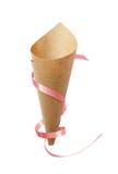 Papierowy kornet z różowym faborkiem Obrazy Stock