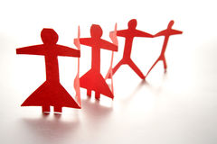 Papierpuppe-Leute-Teamwork stockfotografie