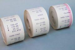 Papierrollen eines Tischrechners Stockfotos