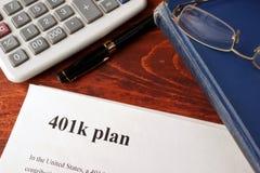 Papiers avec le plan 401k Images libres de droits
