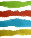 Papiers déchirés colorés d'isolement sur le blanc Photos libres de droits