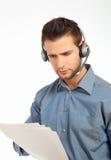 Papiers mâles de fixation de technicien de support Images libres de droits