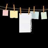 Papiers sur la corde Photo libre de droits