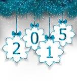 Papierschneeflocken des neuen Jahres mit Bögen Stockfotos