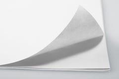 Papierseite mit Rotation lizenzfreie stockbilder