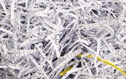Papierstreifen von einem Reißwolf Stockbilder