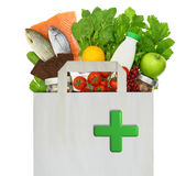 Papiertüte mit medizinischem grünem Kreuz Lizenzfreie Stockfotografie