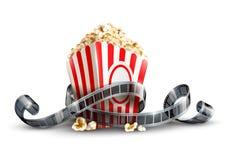 Papiertüte mit Popcorn- und Filmbandspule Lizenzfreies Stockfoto