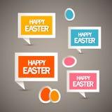 Papiertags mit glücklichem Ostern-Titel und -eiern Stockfotografie