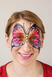 Papillon de peinture de visage Photos stock