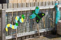 Papillon et un chiffre coloré de serpent Photos libres de droits