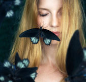Papillon sur le visage Photographie stock