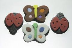 Papillons et coccinelles Image stock