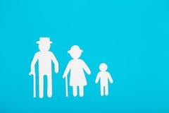 Pappabbildungen der Familie auf einem blauen Hintergrund Das Symbol Stockfoto